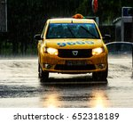 Small photo of 01 June 2017- Bucharest,Romania. A taxi cab on the street, in the rain