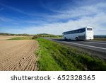 the white bus traveling on the... | Shutterstock . vector #652328365