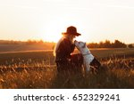 girl with a dog at sunrise ... | Shutterstock . vector #652329241