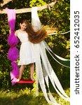 happy child girl on swing in ... | Shutterstock . vector #652412035