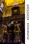 Small photo of April 24, 2017, Seville Cathedral, Seville Spain.Christopher Columbus' tomb is held aloft by four allegorical figures representing Spain's four kingdoms in his time: Castille, Aragon, Navara and Leon.