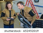 warehouse managers looking at... | Shutterstock . vector #652452019