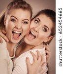 two happy friends women hugging ...   Shutterstock . vector #652454665