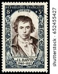 Small photo of Paris, France - July 10, 1950: Jacques-Louis David (1748-1825),French painter in the Neoclassical style, considered to be the preeminent painter of the era. Stamp issued by French Post in 1950.