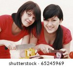 two young happy woman preparing ...