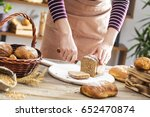 female hands cutting whole... | Shutterstock . vector #652470874