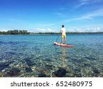 a young tourist guy is paddling ... | Shutterstock . vector #652480975