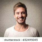 young man smiling | Shutterstock . vector #652495045