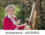 A smiling senior woman is in an ...