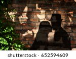 Shadow On The Wall Of People...