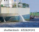 tanker discharging ballast into ... | Shutterstock . vector #652624141