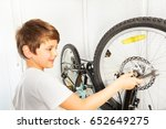 boy using a spanner while... | Shutterstock . vector #652649275