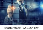 businessman in dark office | Shutterstock . vector #652654129