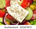 Closeup view of fresh greek salad - stock photo