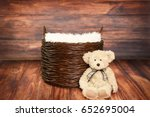Stock photo digital photography background of rustic wood backdrop and woven basket with teddy bear 652695004