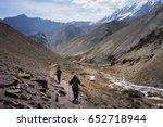a man and a woman trekking on...   Shutterstock . vector #652718944