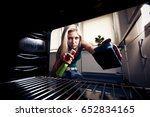 cleaning the oven | Shutterstock . vector #652834165