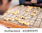People Playing Chinese Chess I...