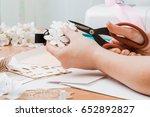 girl's hand cut paper ... | Shutterstock . vector #652892827