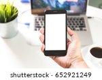 man hands on smartphone on desk ... | Shutterstock . vector #652921249