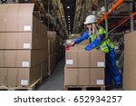 Female Warehouse Worker Packing ...