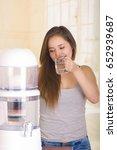 beautiful woman drinking a... | Shutterstock . vector #652939687