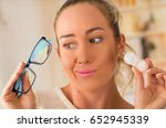 young blonde woman holding... | Shutterstock . vector #652945339