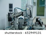 robot and cylinder | Shutterstock . vector #652949131