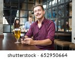 smiling man with smartphone and ... | Shutterstock . vector #652950664