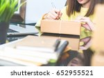 employees write a parcel to...   Shutterstock . vector #652955521