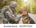 Stock photo soldier with military working dog on blurred background 652957324