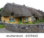 Typical Thatched Roof Cottage in Ireland, in the quaint town of Adare - stock photo