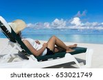 woman in relaxation on tropical ... | Shutterstock . vector #653021749