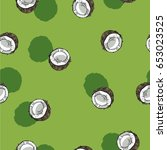 seamless pattern with coconuts... | Shutterstock .eps vector #653023525