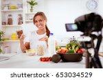 beautiful young woman filming... | Shutterstock . vector #653034529