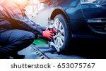 car mechanic installing sensor... | Shutterstock . vector #653075767