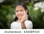 beautiful asian girl holding... | Shutterstock . vector #653089525