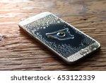 closeup wet smartphone drops on ... | Shutterstock . vector #653122339