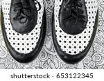 black and white leather shoes... | Shutterstock . vector #653122345