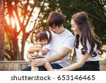 portrait of happy asian family... | Shutterstock . vector #653146465