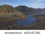 mountain river flowing into... | Shutterstock . vector #653147281