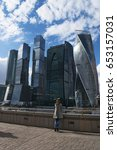 Small photo of Russia, 27/04/2017: a woman in front of the new skyline with the skyscrapers of Moscow International Business Center, know as Moscow City, a commercial district in Presnensky District