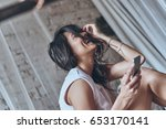 laughing out loud. attractive... | Shutterstock . vector #653170141