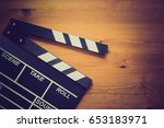movie clapper on wood table ... | Shutterstock . vector #653183971