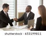 two cheerful businessmen... | Shutterstock . vector #653199811