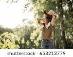 mother and daughter walking   Shutterstock . vector #653213779