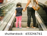 back view of mother and child... | Shutterstock . vector #653246761