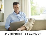 shot of a handsome mature man... | Shutterstock . vector #653254399