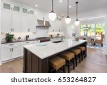 Stock photo kitchen interior with island sink cabinets and hardwood floors in new luxury home 653264827