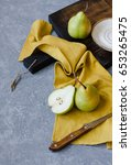 Three Pears On Yellow Textile....